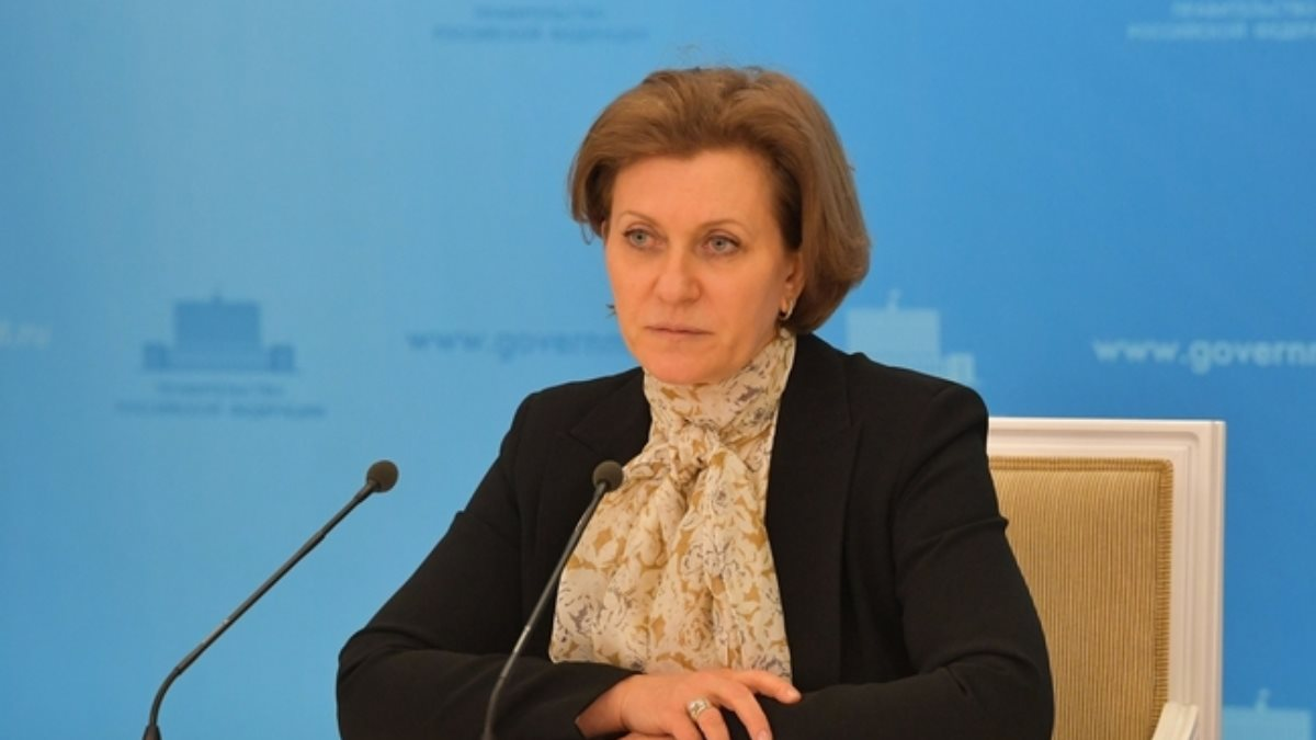 Глава Роспотребнадзора Анна Попова синий фон