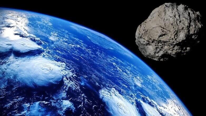 Астероид справа голубая Земля метеорит