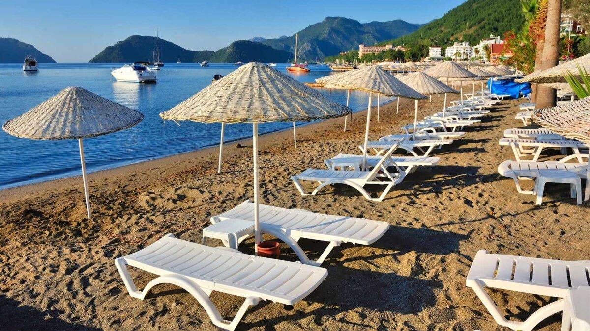 Турция песок море пляж зонтики