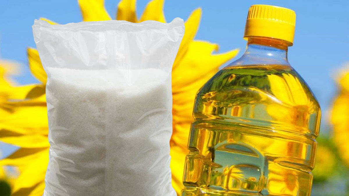 бутылка подсолнечного масла и пачка сахара