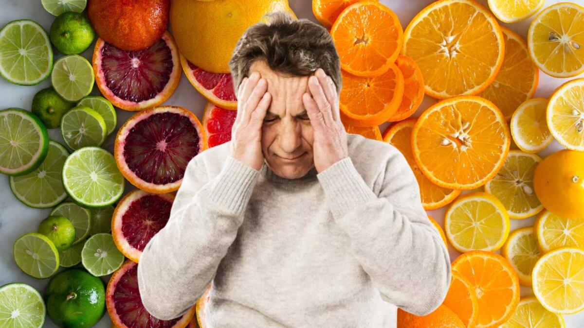 Мужчина усталость головная боль на фоне фрукты витамин С