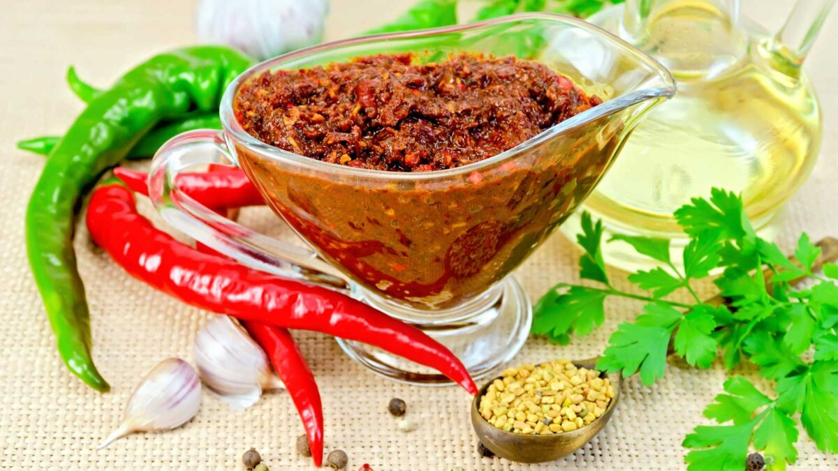 Tabasco adjika in a glass gravy boat, hot pepper, garlic аджика острый перец горчица тобаско чеснок
