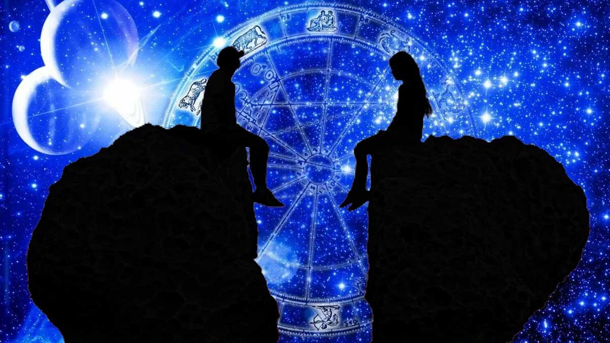 парень и девушка сидят на камнях на фоне знаков зодиака