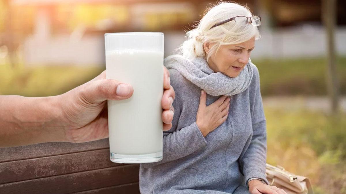 женщина страдает от сердечного приступа