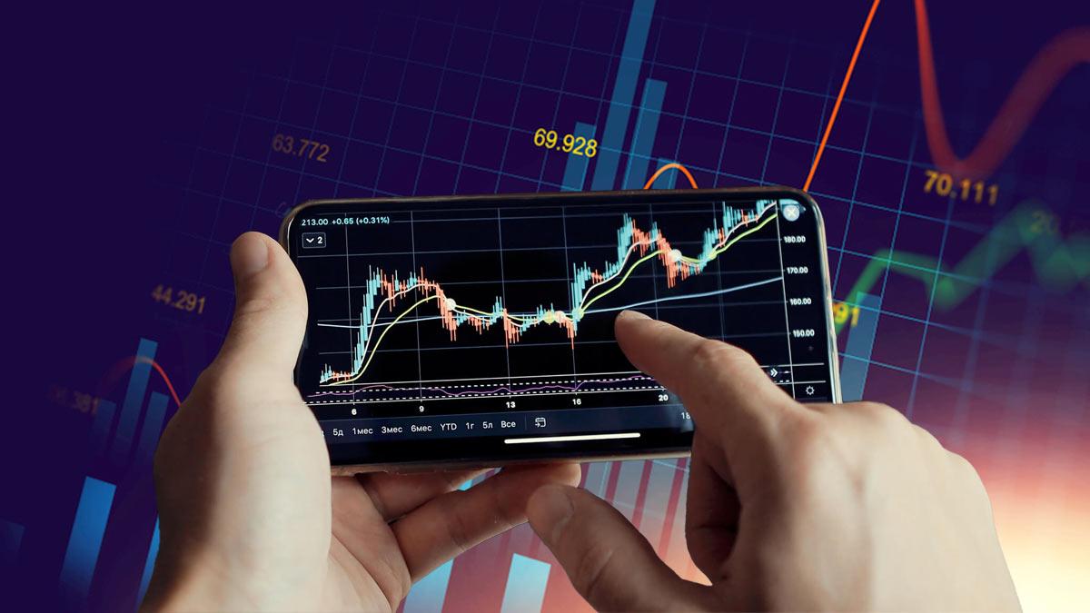 акции биржа мужчина отслеживает графики