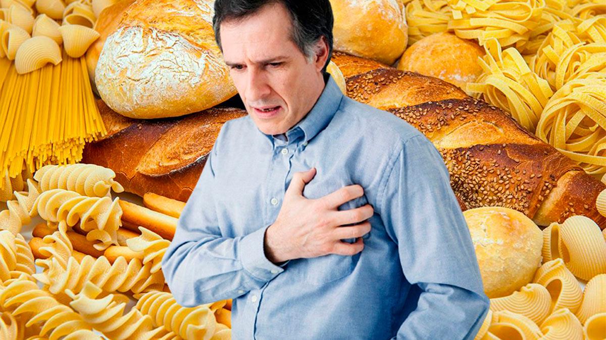мужчина держится за сердце макароны хлеб