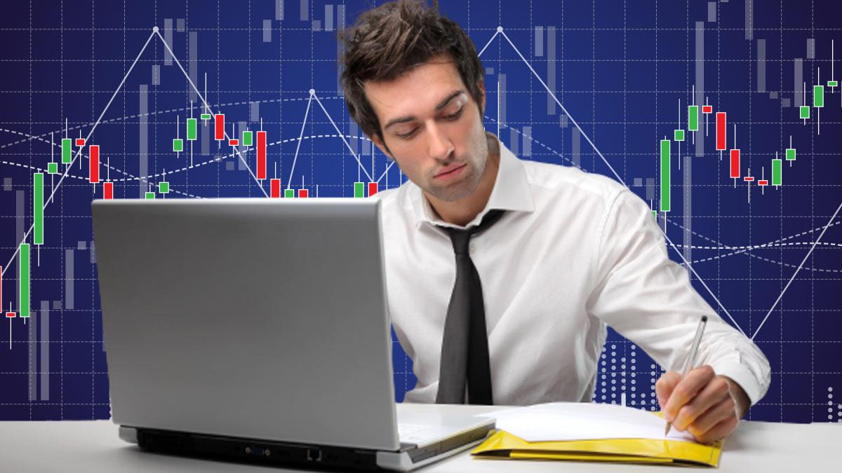 мужчина графики акции цифры